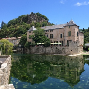 Reflections of the Restaurant du château in a river, Lunas