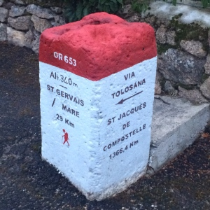 Red and white cement marker 29kms to St Gervais sur Mare
