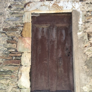 Old door with coloured stonework