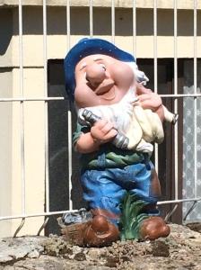 Gnome holding a nautical telescope