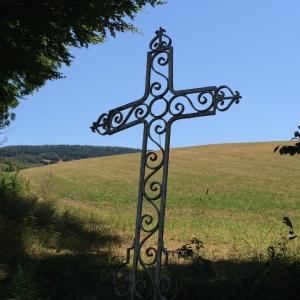 A metal filigree cross