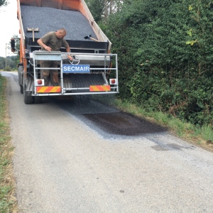 Man on bitumen laying truck
