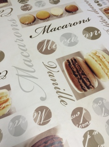 Tablecloth with macarons printed on it